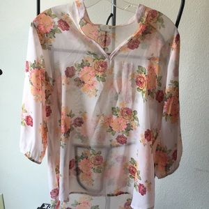 Flower patterned blouse.